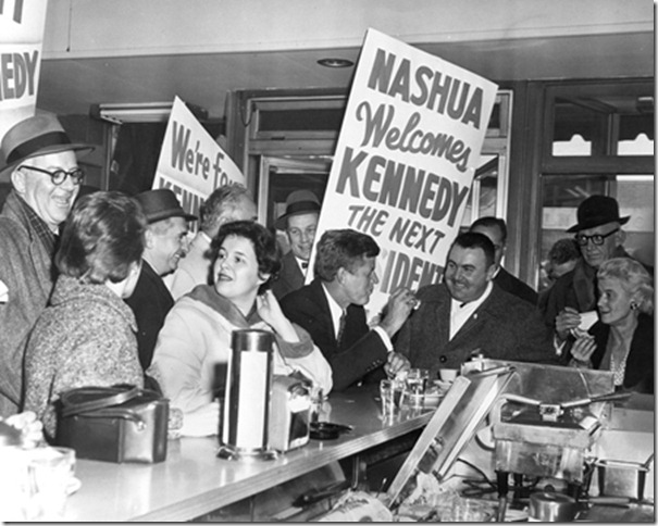 Senator John F. Kennedy of Massachusetts stops in a diner in Nashua, New Hampshire, during the New Hampshire Primary Campaign. Photograph in the John F. Kennedy Presidential Library and Museum, Boston.