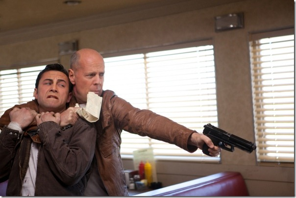Joseph Gordon-Levitt shares the screen and a character with Bruce Willis in Looper