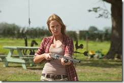 Emily Blunt as Sarah protects her famr in Looper