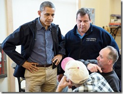 """President Barack Obama and New Jersey Gov. Chris Christie talk with local residents at the Brigantine Beach Community Center in Brigantine, N.J., about dealing with the aftermath of Hurricane Sandy. Oct. 31, 2012. (Official White House Photo by Pete Souza)."""