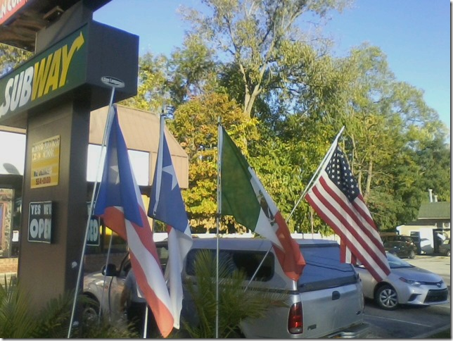 2017 10 04 Unidos Flags outside Bobbys Burritos