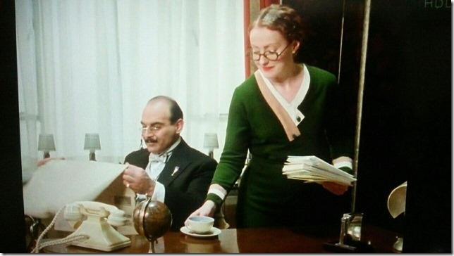 Poirot Miss Lemon serves tea