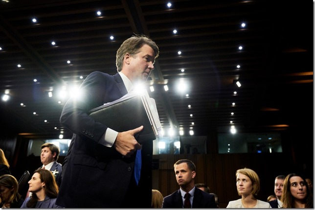 Kavanaugh Brett Kavanaugh carrying papers and book as if he is serious about the law TJ Kirkpatrick NY Times