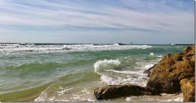 Alabama Gulf State Park Beach Waves breaking on the rocks photo via Alabama State Parks