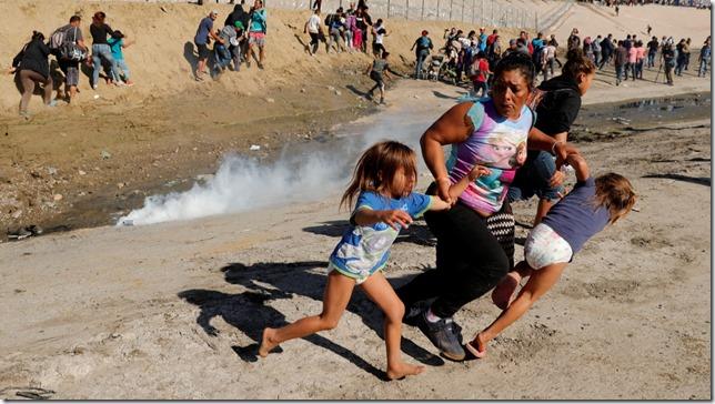 Trump The Wall Tear gas Kim Kyung Hoon Reuters via the Daily Beast