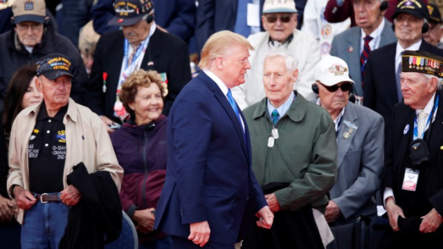 Trump Why am I here again and who are these old guys Donald Trump walks past World War II veterans at a D Day ceremony in Normandy CHRISTIAN HARTMANN  REUTERS