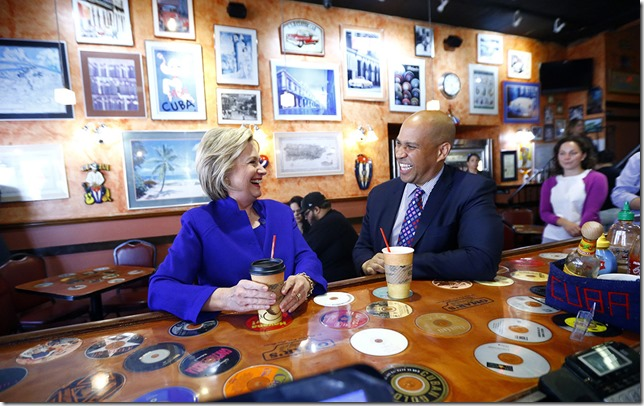 HRC Democratic presidential candidate Hillary Clinton talks with Sen. Cory Booker at Omar's Cafe while campaigning Wednesday June 1 2016 in Newark  AP photo via politico