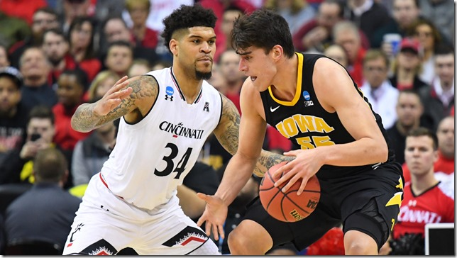Basketball NCAA Mens March Madness 2019 Cincinatti v Iowa Beartcat Guard Jarron Cumberland goes up against Hawkeye Forward Luke Garza March 22 2019 Screenshot via CBS Sports