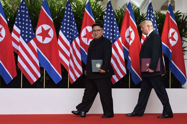 Trump The old soft shoe Kim Jong Un and Trump in Singapore June 2018 Uncredited Reuters photo via Times Herald
