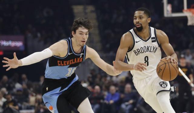 NBA Nets Spencer Dinwiddie dribbling around Cavs Cedi Osman 11 25 19 Tony Dejak AP via NYDN