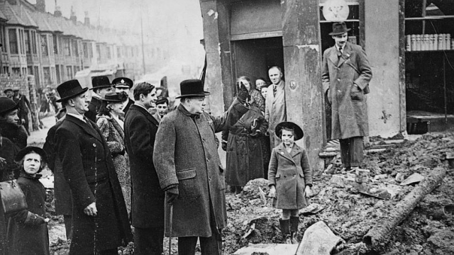 Churchill Visiting bombed out neighborhood during the Battle of Britain via Democrtic Underground