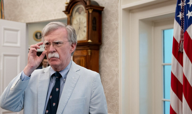 Trump Bolton 2 The idiot said WHAT Then national security adviser John Bolton in the Oval Office Erin Schaff NYT