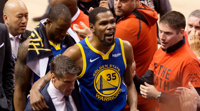 NBA Warriors 2019 Finals Game5 June 10 Durant helped off court Chris  Young Canadian Press via AP - Edited