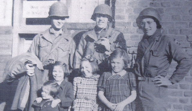 Kissinger Pvt Henry Kissinger and fellow GIs with German children at the end of WW II