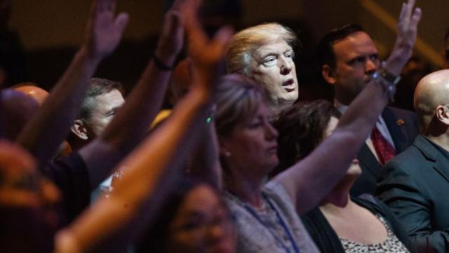 Trump Flawed vessel praying Candidate Trump at a service at International church of Las Vegas 10 30 16 Evan Vucci AP via WBUR - Edited
