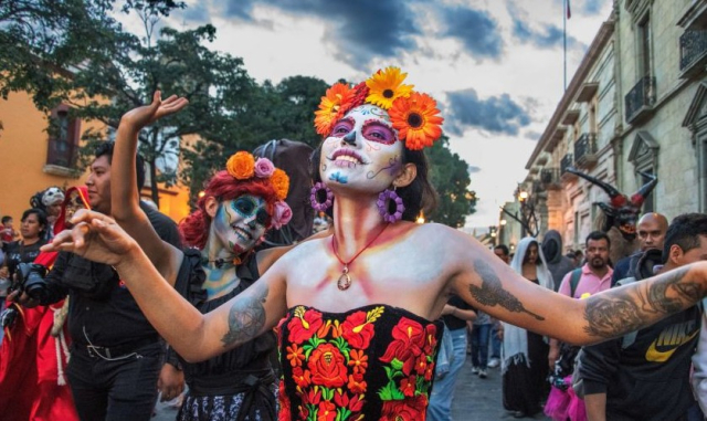 Poets and Writers Theroux Plain of Snakes Day of the Dead dancers Steve McCurry HMH via LA Times - Edited