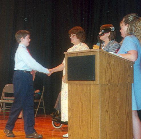 The_graduate_receives_his_certificate_03